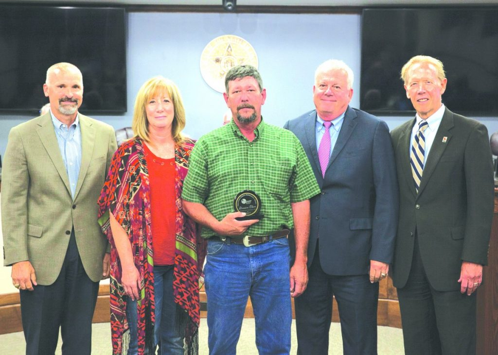 The Director's Safety Award was presented to the Okfuskee County crew of the Oklahoma Department of Transportation at its Oklahoma City headquarters on Monday. Pictured from left are Division Three Engineer Kevin Bloss, Safety Manager Annette Nichols, Okfuskee County Maintenance Crew Supervisor Joe Bradley, District Three Commissioner Dan Overland and ODOT Executive Director Mike Patterson.