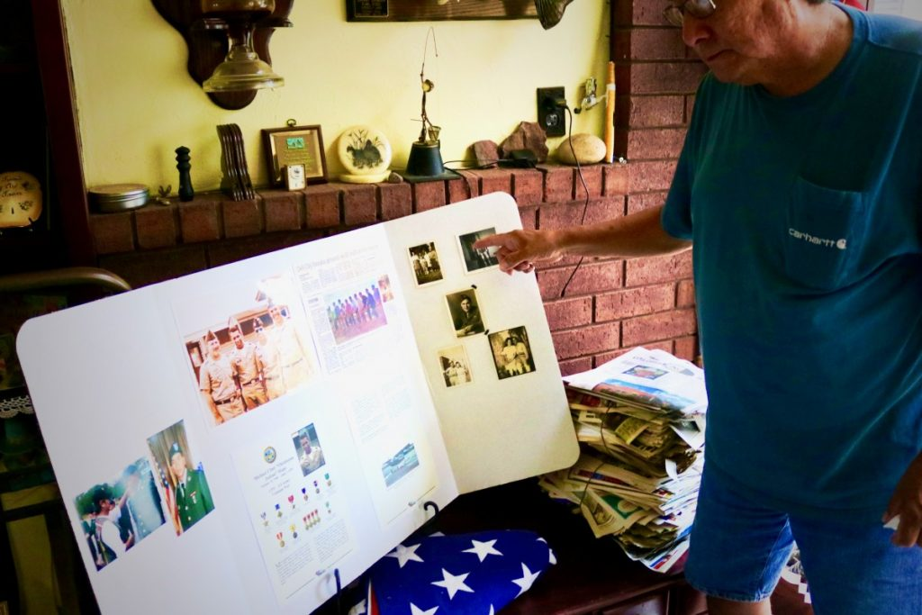 """Okemah resident, Johnny Johnson, points to some old pictures of his cousin, decorated Vietnam vet Michael C. Hope, who was known as the """"Oklahoma Indian"""" and is now the namesake (in memoriam) of Del City's new central fire station. The didication of which was held Friday before eager citizens, elected officials and city staff.  (JOSH ALLEN/News Leader)"""